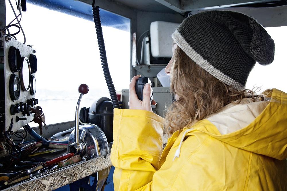 lady using a vhf radio